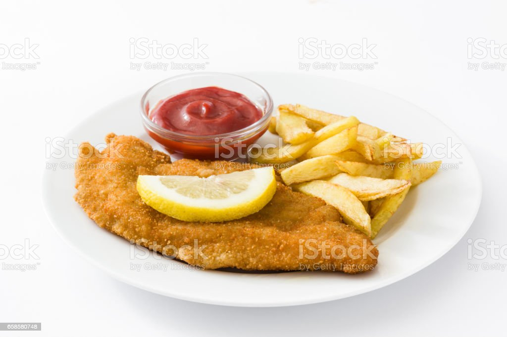 Weiner schnitzel with fried potatoes stock photo
