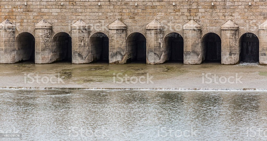 Weir across a river to regulate its flow stock photo