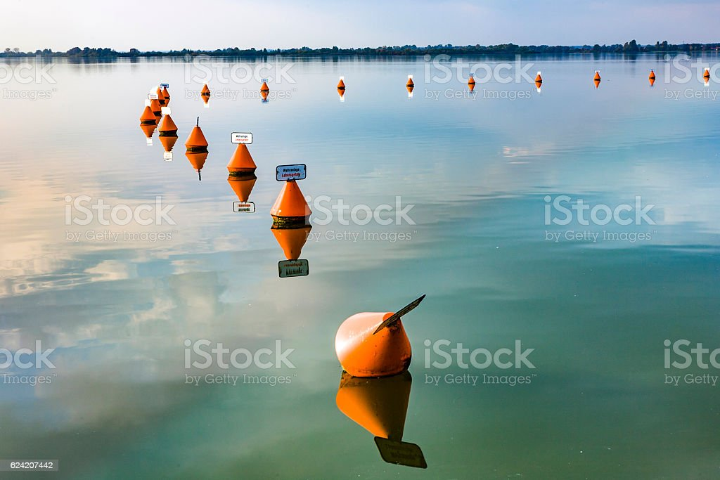 weir at altmuehl lakewith scenic reflection stock photo