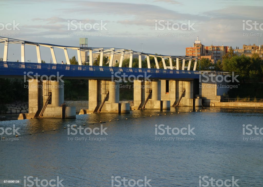 weir at the lower side from the upper part on the Ebro river at sunrise, Saragossa stock photo