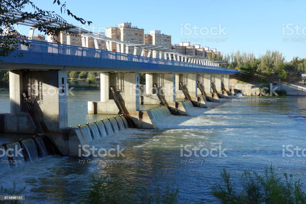 weir at the lower side from the upper part on the Ebro river, Saragossa stock photo