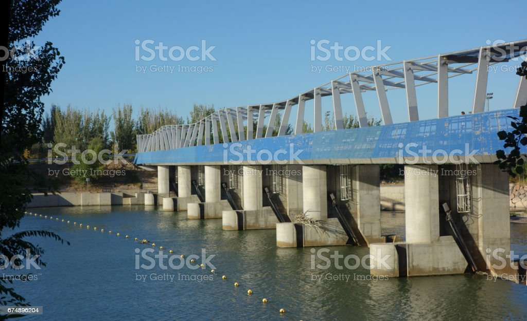 weir at the upper side from the upper part on the Ebro river, longer view. Saragossa stock photo