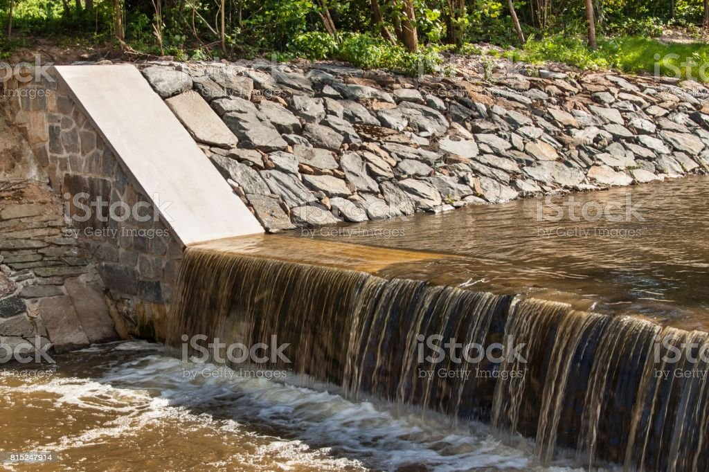 Weir on a river. Corrected trough on a rural river in the Czech Republic. stock photo