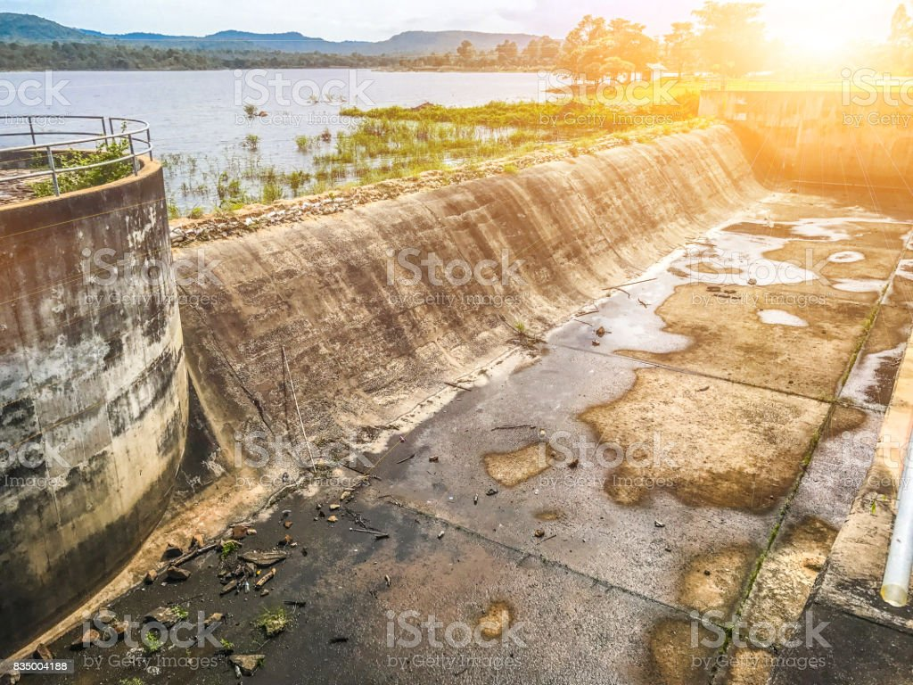 Weir overflows and the sun shines. stock photo