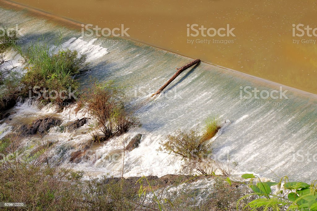 Weir to irrigate - Small ditch with a weir stock photo