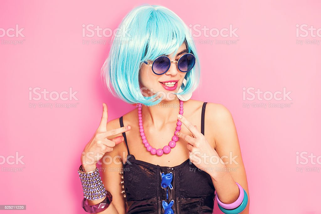 Weird and funny pop girl portrait wearing blue wig stock photo