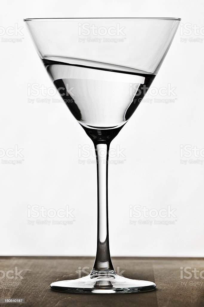 weired crooked cocktail glass stock photo