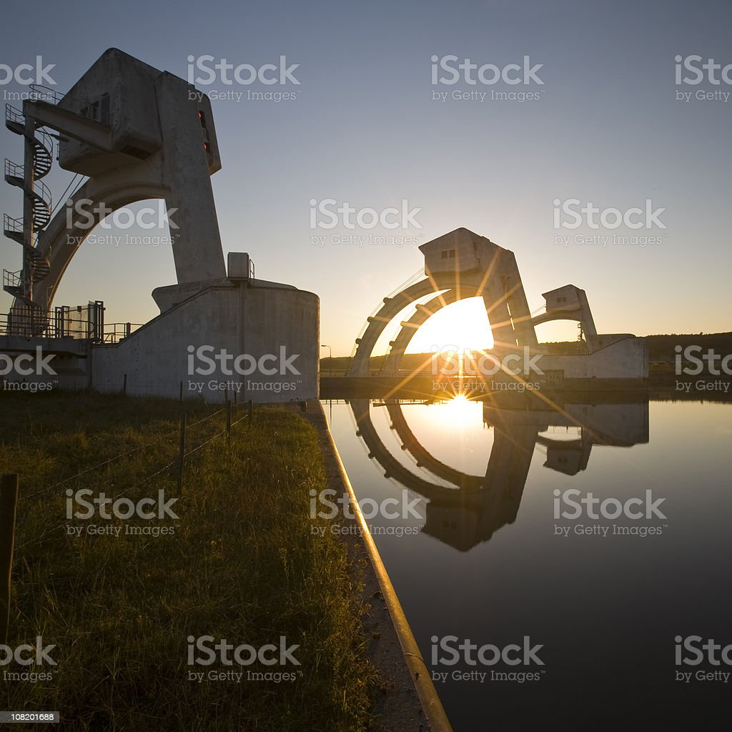 Weirs in a river at sunset royalty-free stock photo
