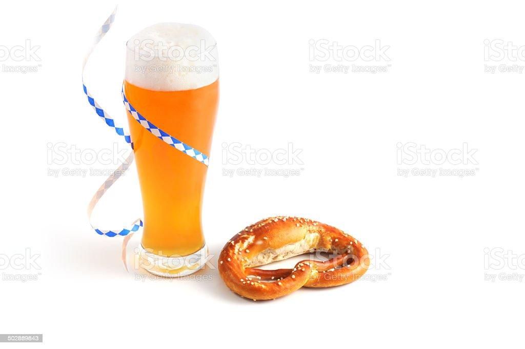 Weissbier with bavarian streamer and pretzel stock photo
