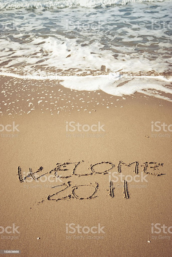 Welcome 2011 message in the sand royalty-free stock photo