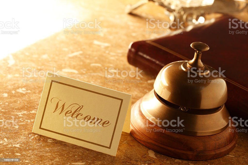 Welcome card and service bell on marble countertop in hotel stock photo