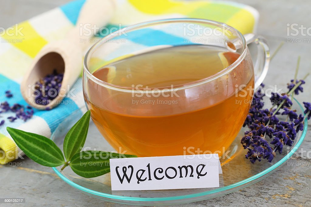 Welcome card with cup of tea and lavender stock photo