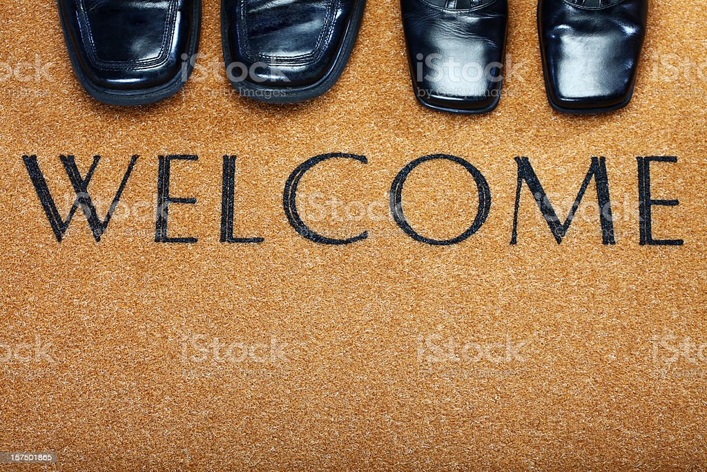 Welcome Door Mat with Shoes stock photo