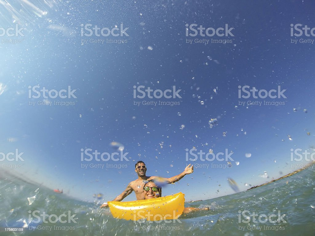 Welcome Holidays, young woman on airbed stock photo