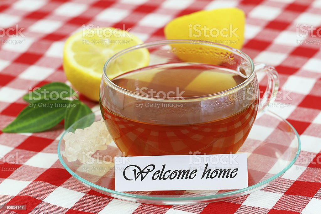 Welcome home card with cup of tea and lemon stock photo