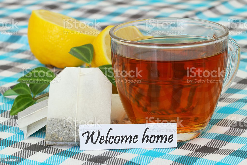 Welcome home card with cup of tea stock photo
