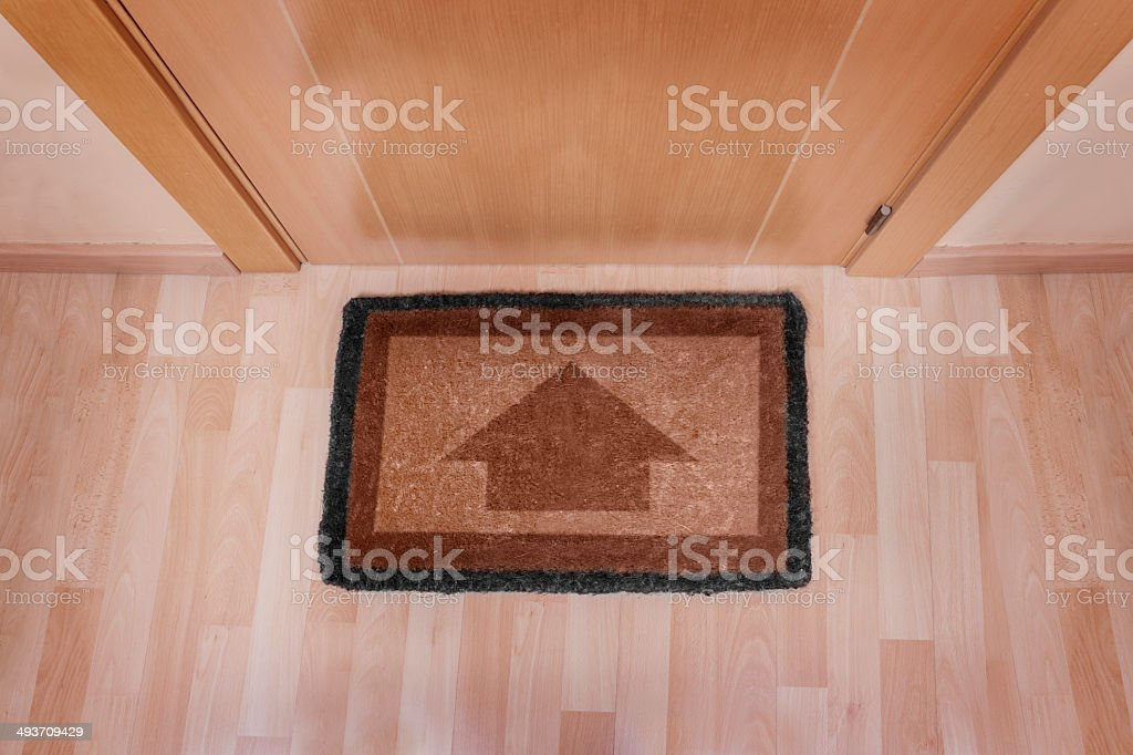 Welcome home doormat with arrow royalty-free stock photo
