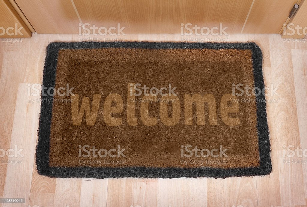 Welcome home doormat with closed door royalty-free stock photo