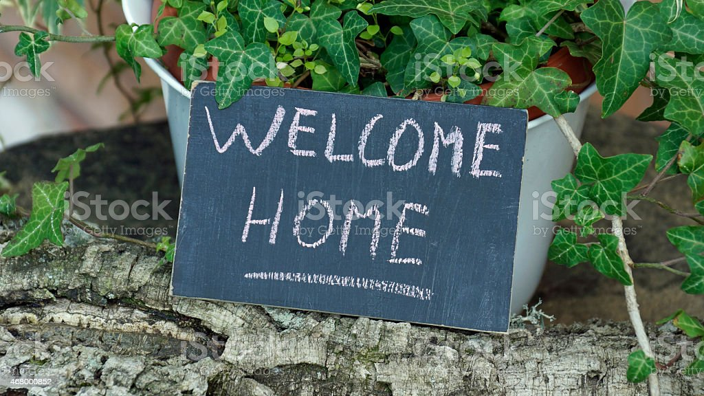 Welcome home written stock photo