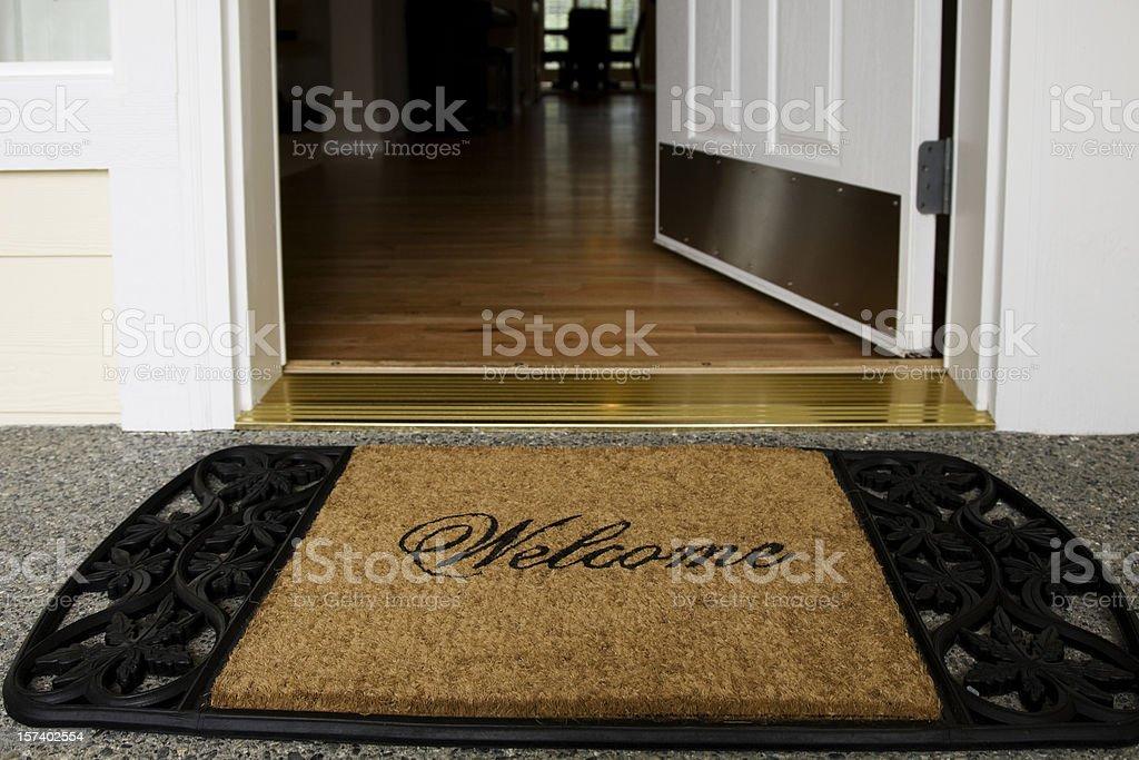 Welcome mat entrance new home door wood floor clean inviting stock photo