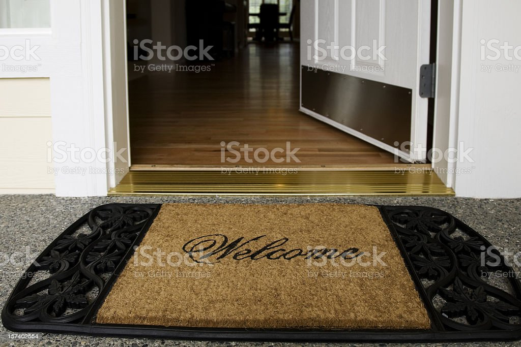 Welcome mat entrance new home door wood floor clean inviting stock photo