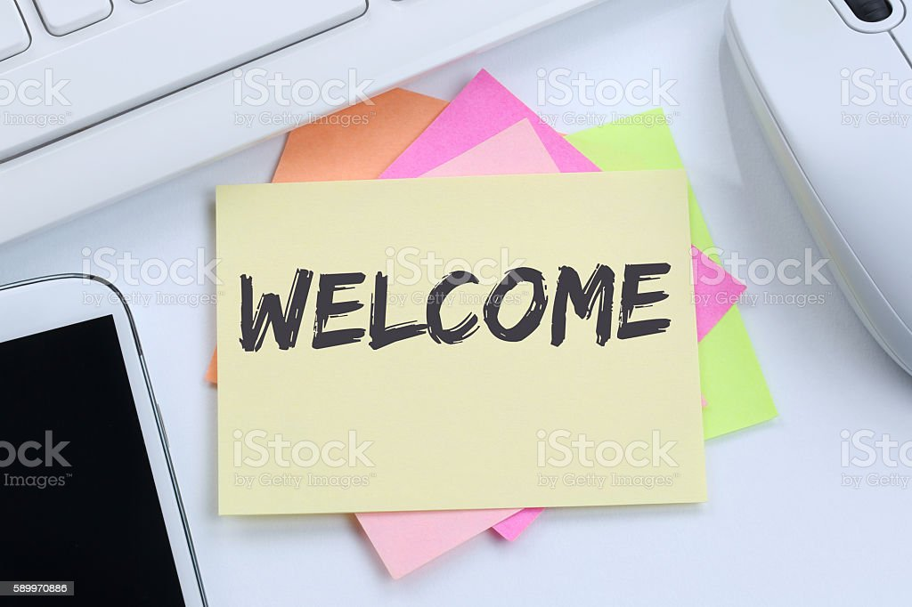 Welcome new employee colleague refugees refugee immigrants desk stock photo