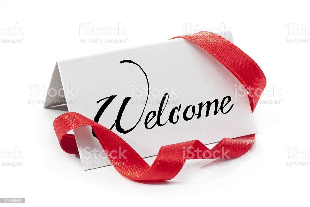 Welcome placard with red ribbon royalty-free stock photo