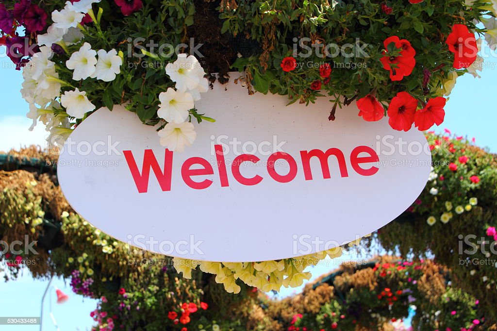 welcome sign and flowers stock photo