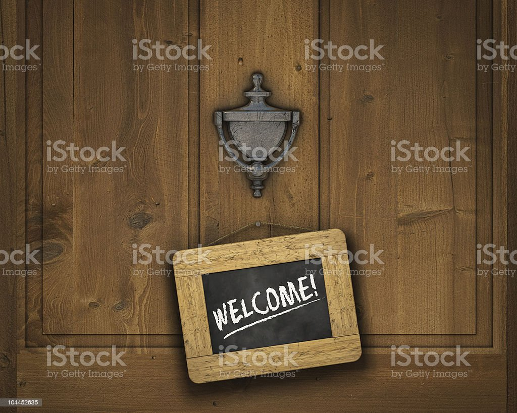 Welcome sign hanging on a wooden door stock photo