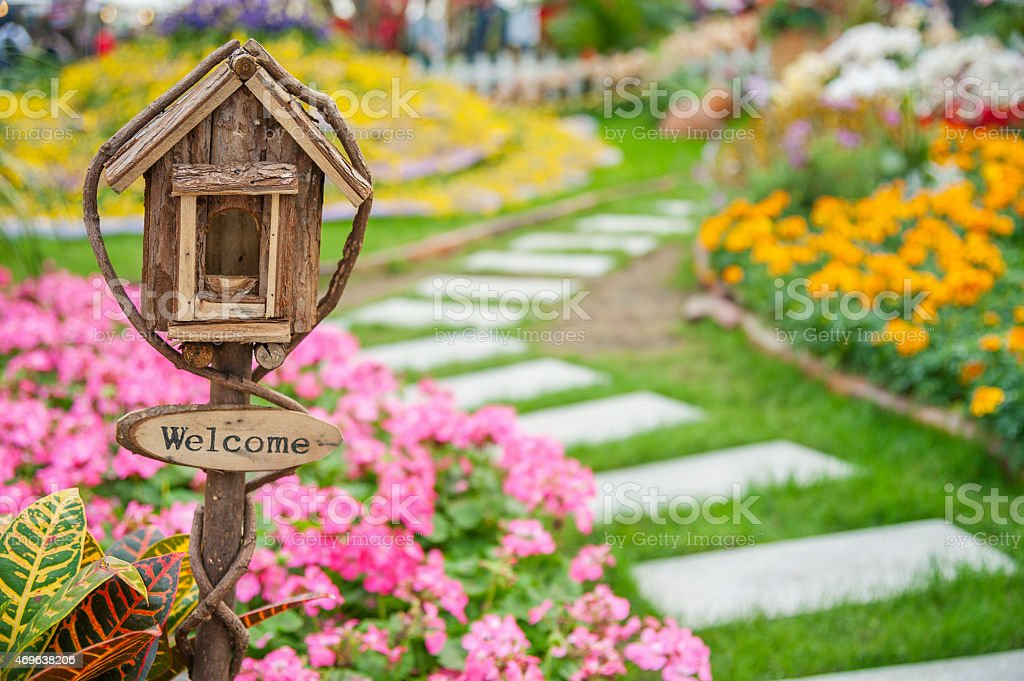 Welcome sign on colorful garden stock photo