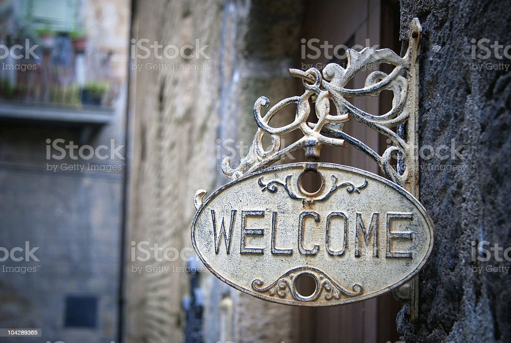 Welcome sign on log home stock photo