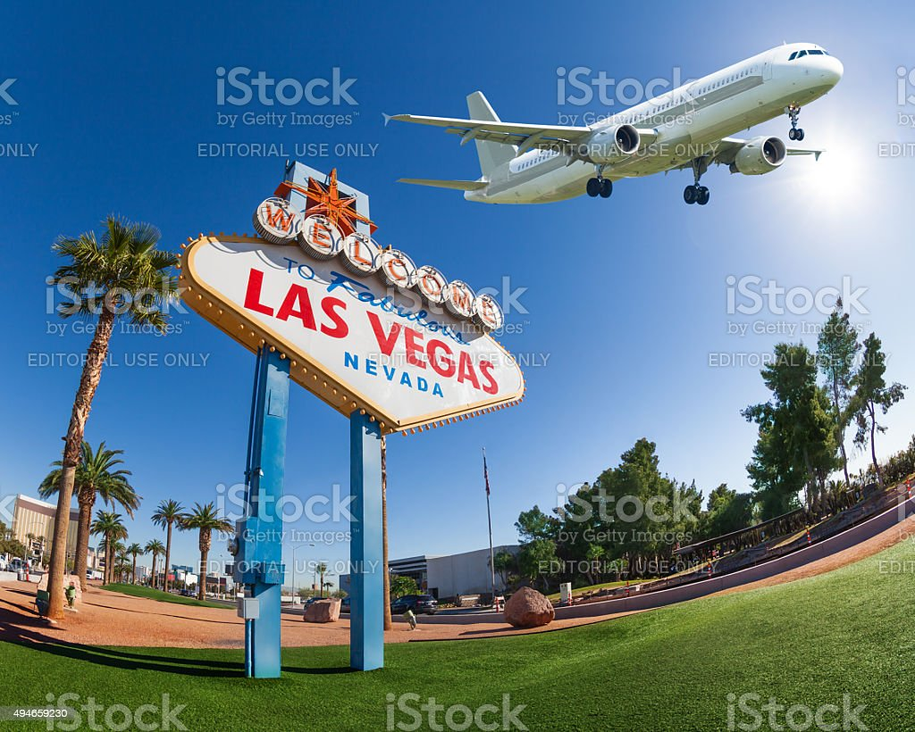 Welcome sign to Las Vegas with airplane in the sky stock photo