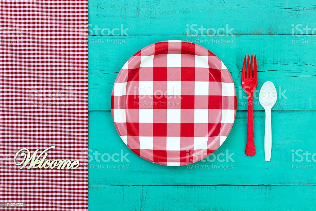 Welcome sign with picnic plate on teal blue background stock photo