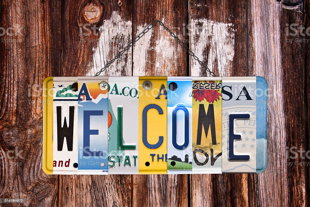 Welcome sign written with recycled US license plates stock photo