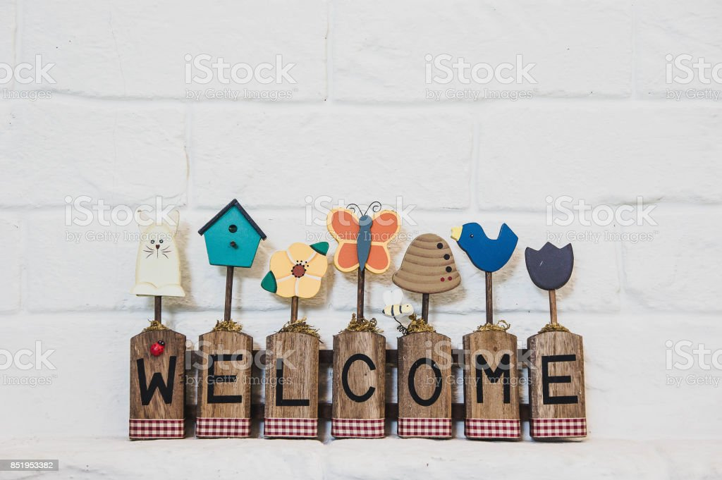 welcome text lable on wall background stock photo