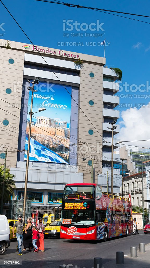 Welcome to Greece - Billboard frame with double decker bus stock photo