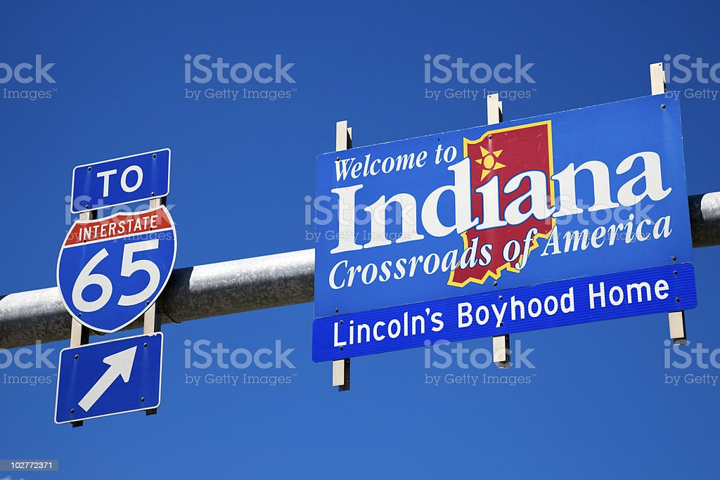 Welcome to Indiana road sign against blue sky. stock photo