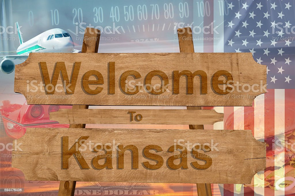 Welcome to Kansas state in USA sign on wood, stock photo