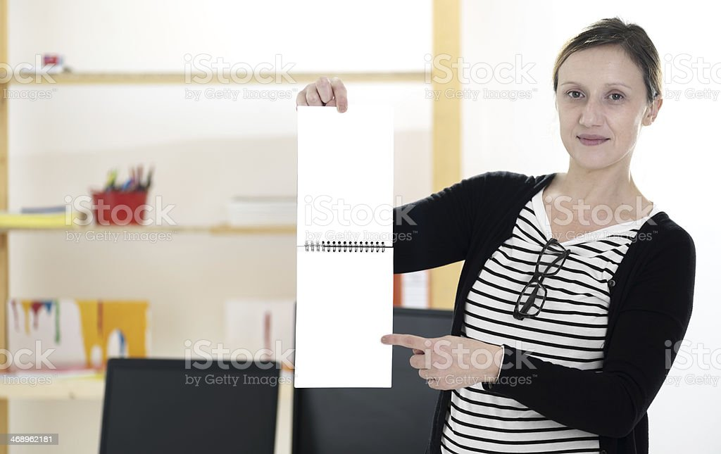 Welcome to my studio: Presenting spiral binded notebook stock photo