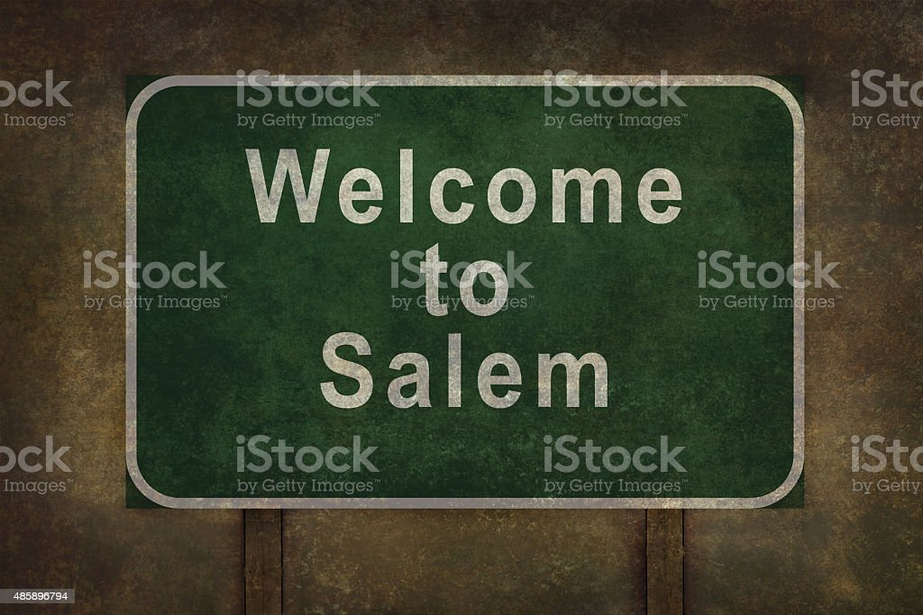 Welcome to Salem roadside sign, with distressed ominous background stock photo
