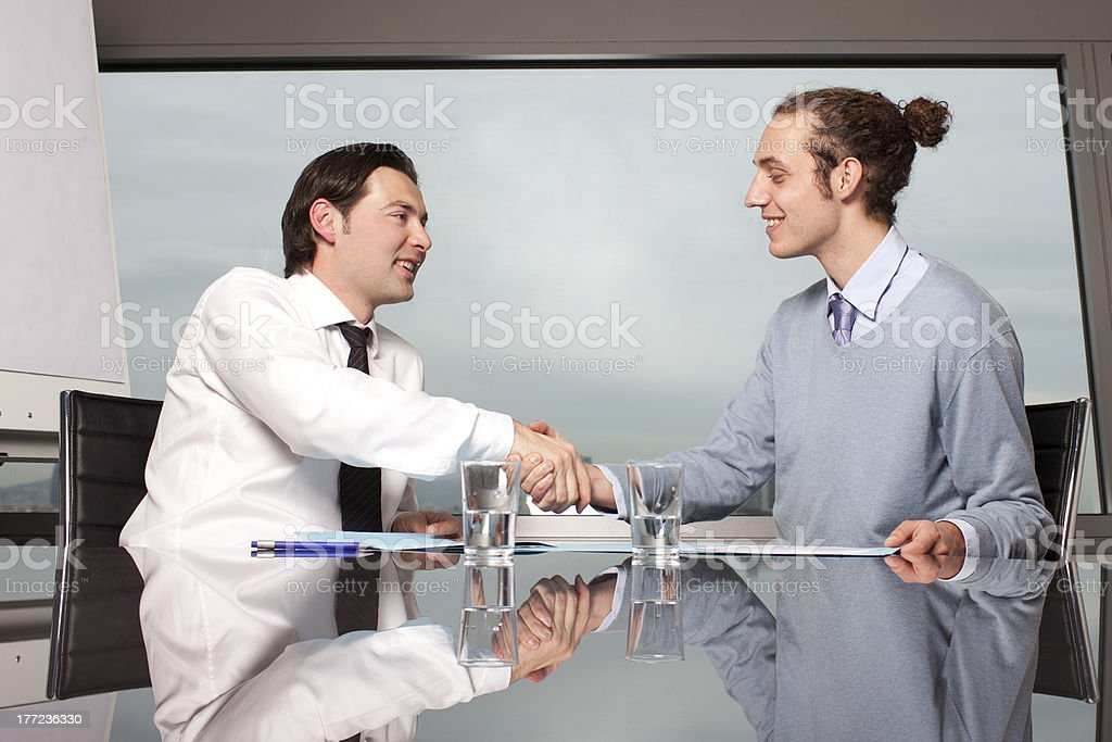 Welcome to the new job shaking hands royalty-free stock photo