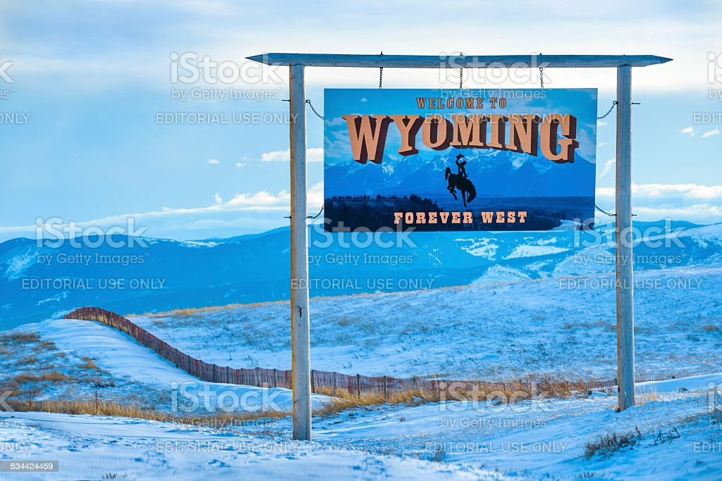 Welcome to Wyoming Highway Road Sign Winter Snow blue stock photo