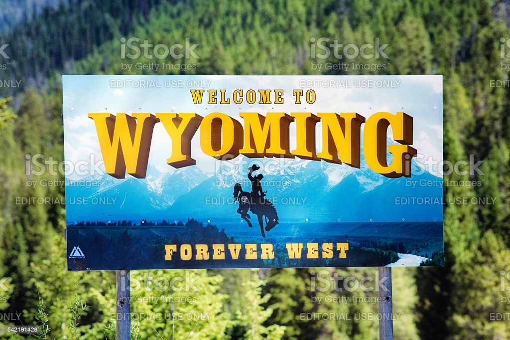 Welcome to Wyoming sign with forest background stock photo