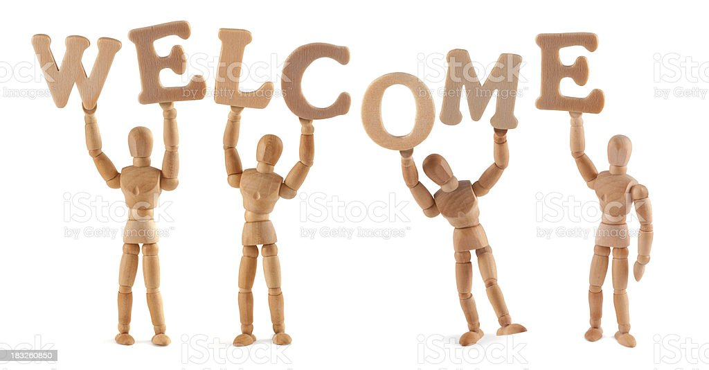 Welcome - wooden mannequin holding this word stock photo