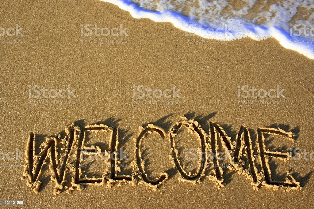 Welcome, word written on the sand royalty-free stock photo