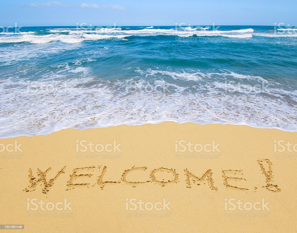 welcome written in a sandy beach royalty-free stock photo