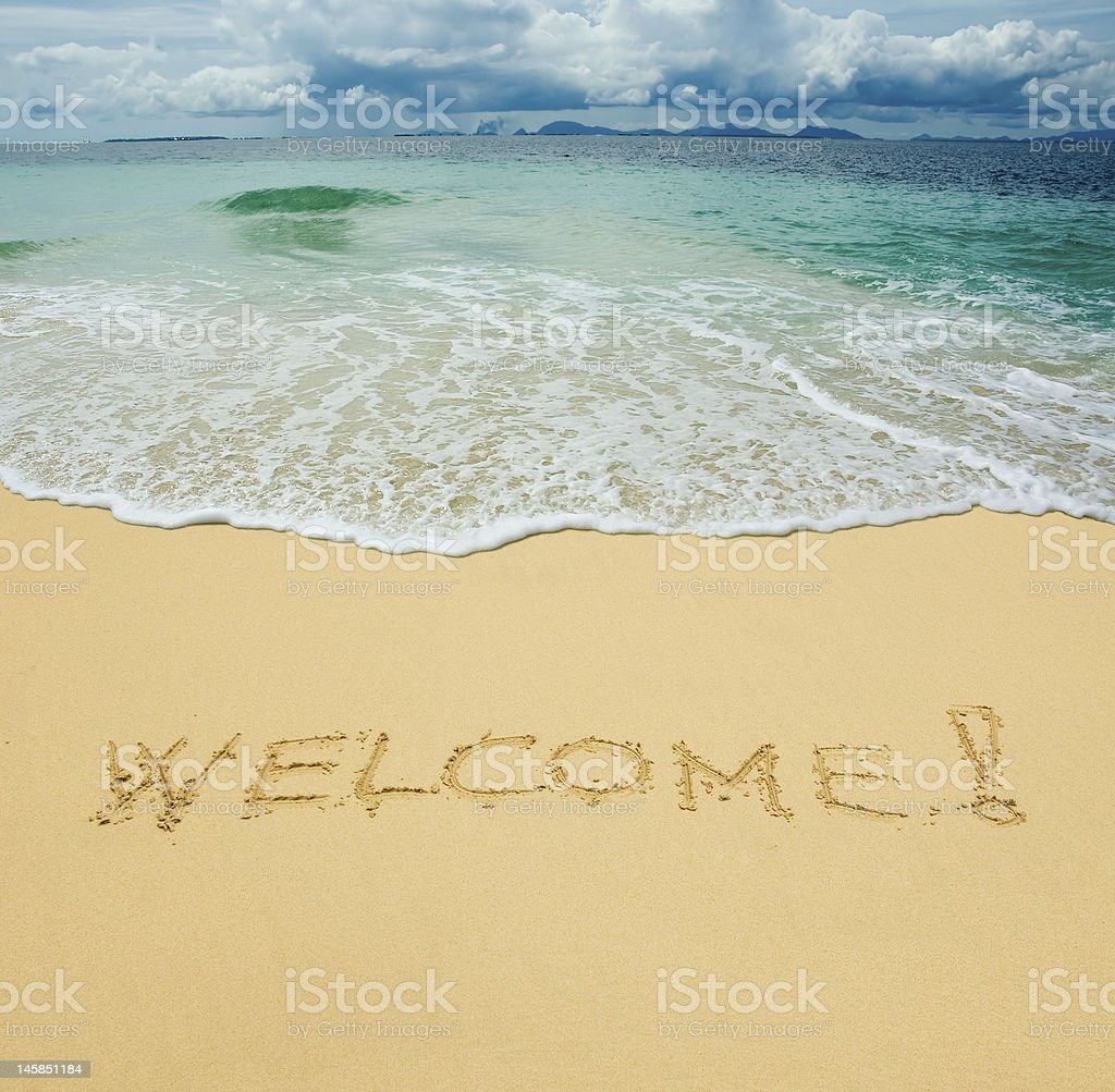 welcome written in a sandy tropical beach royalty-free stock photo