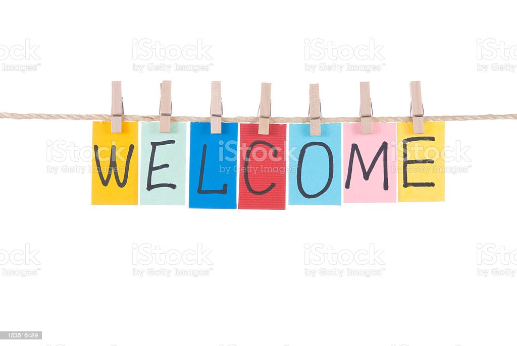 Welcome,words hang by wooden peg stock photo