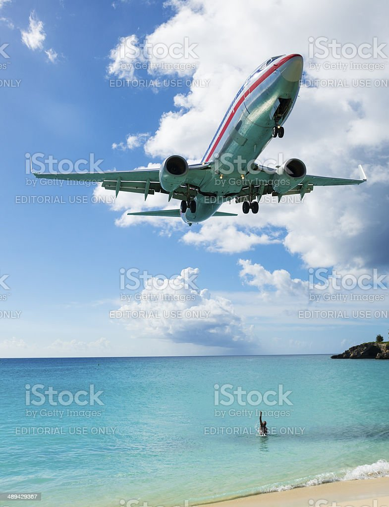 Welcoming an arriving American Airlines plane on St. Maarten stock photo