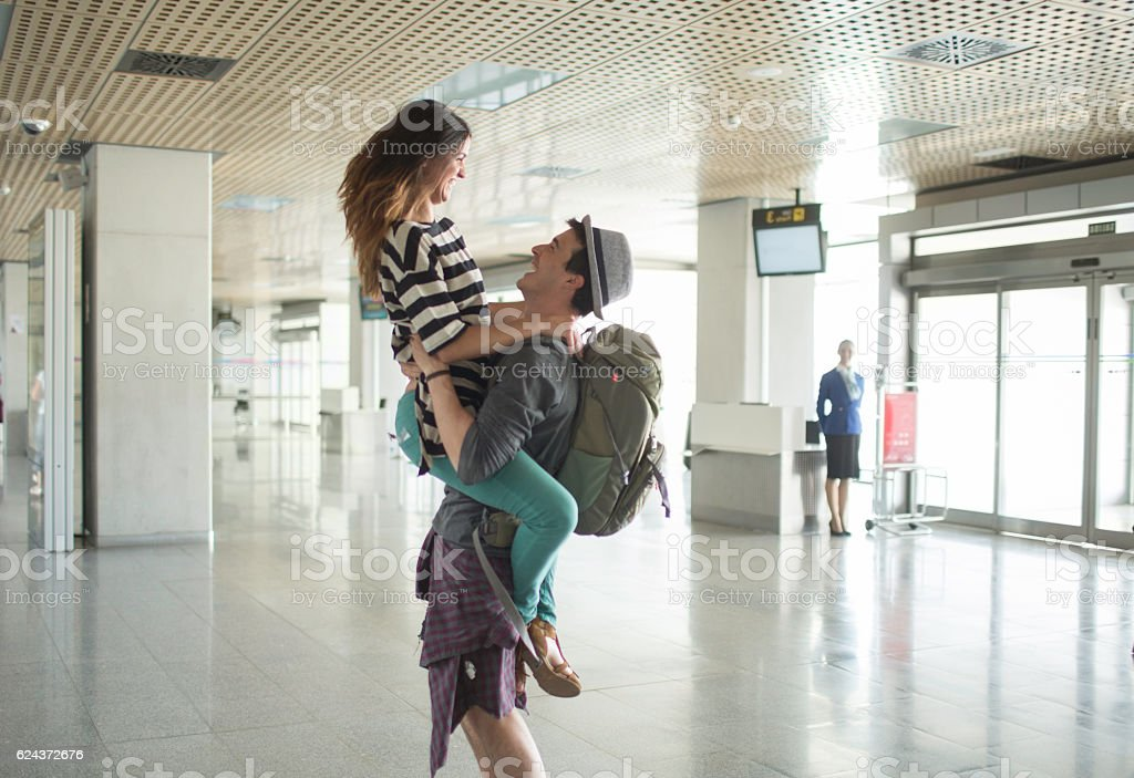 Welcoming boyfriend at the airport. stock photo